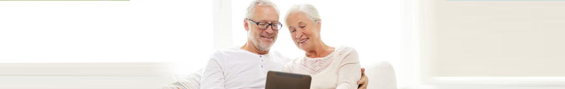 an elder couple watching something on phone